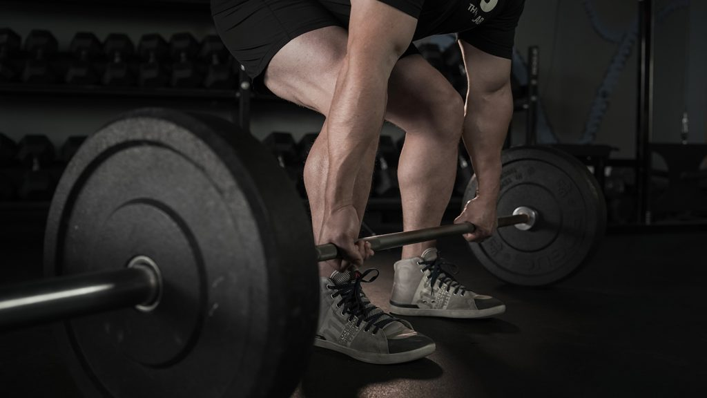 Image of a man performing a dead lift.